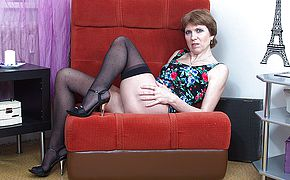 <b>Naughty</b> housewife playing with her toy