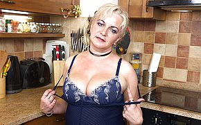 <b>Naughty</b> housewife playing in the kitchen