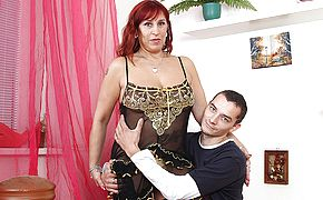 Naughty mature slut fucking her <b>toy boy</b>