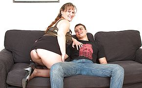 Big breasted housewife fucking with her <b>toy boy</b>