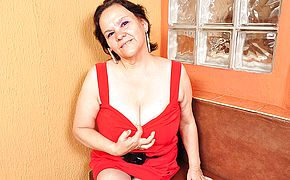 <b>Big breasted</b> Latin mama playing with her toy
