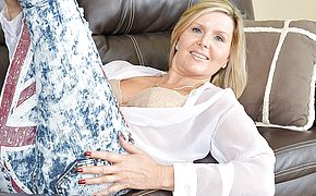 Hot British MILF masturbating on the couch