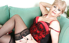 British <b>MILF</b> pleases herself on couch