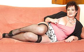 <b>Chubby</b> Mature lady fingering on the couch