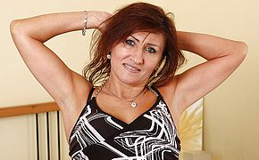 Horny mature redhead playing with herself