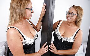 Naughty housewife in glasses playing with her <b>pussy</b>