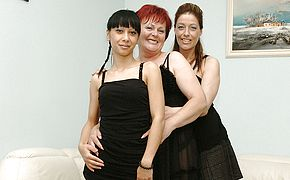 Three <b>old and young</b> lesbians playing on the couch