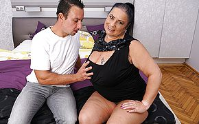 Big breasted mature BBW doing her <b>toy boy</b>