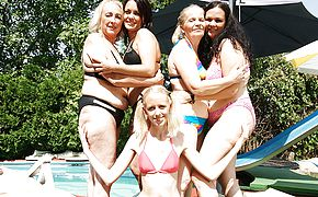 Five <b>old</b> and young lesbians do eachother at the pool