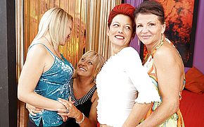 Four <b>old</b> and young lesbians having a party on bed