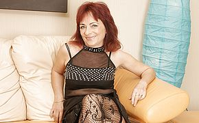 Mature redhead loves to work her <b>hairy</b> pussy
