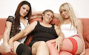 Three naughty <b>old</b> and young lesbians do it on the couch