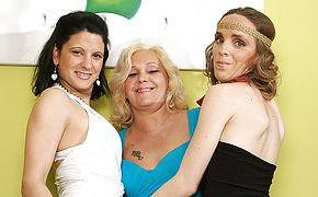 Three <b>old</b> and young lesbians have fun on the couch