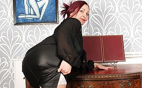 Naughty British housewife fooling around at the office
