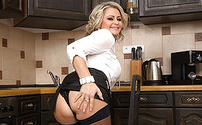 <b>Naughty</b> MILF masturbating in the kitchen