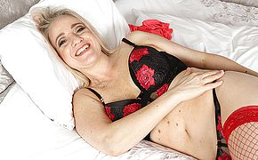 Naughty <b>mom</b> playing with herself in bed