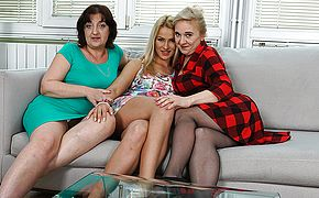 Three <b>old</b> and young lesbians having a ball on the couch